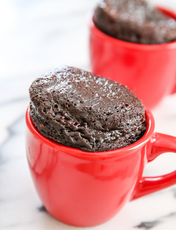 photo of a mug cake with another one in the background