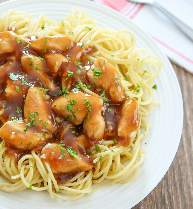 close-up photo of a plate of orange chicken pasta