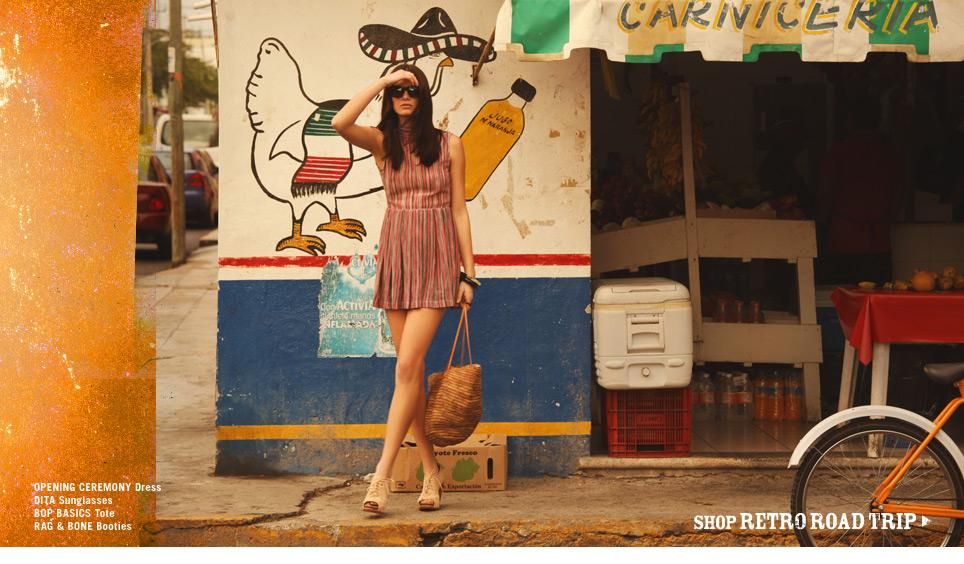 2c127723d40 The model looks spectacular in this vertical striped short dress by Opening  Ceremony