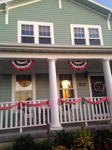 White front porch, patriotic porch, red and white striped bunting banner