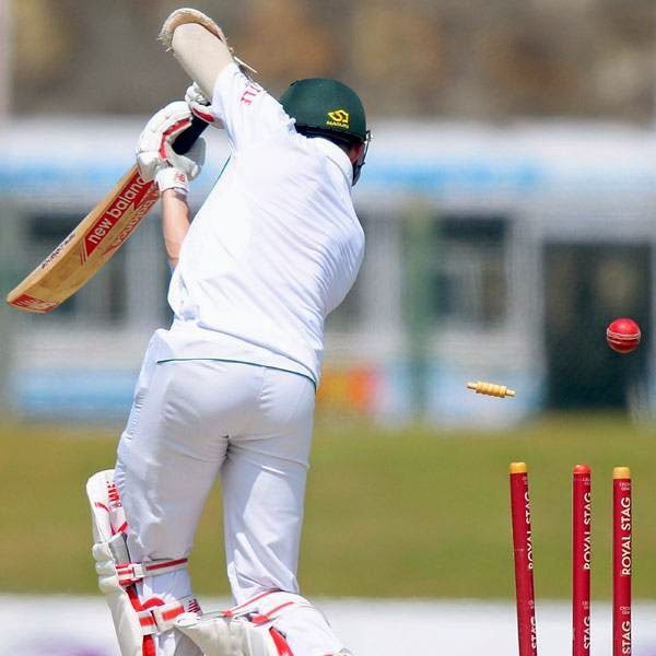 South Africa cricketer Dale Steyn is dismissed by Sri Lankan cricketer Suranga Lakmal during the second day of the opening Test match between Sri Lanka and South Africa at the Galle International Cricket Stadium in Galle on July 17, 2014.