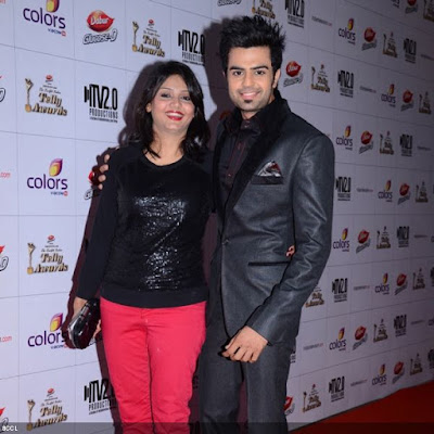Manish Paul with his wife Sanyukta poses for lensmen during the 12th Annual Indian Telly Awards, held in Mumbai.
