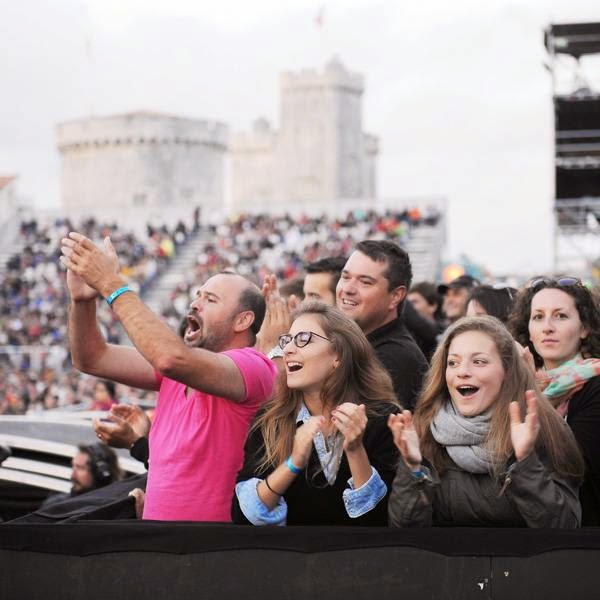 People attend a concert during the Francofolies festival in La Rochelle on July 12, 2014.