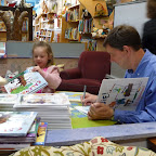 Will Hillenbrand signs some of his books