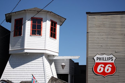 Shops and Phillips 66 sign in La Conner, Washington