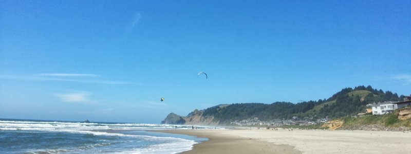 Parasails in a strong wind on the beach at Lincoln City, Oregon