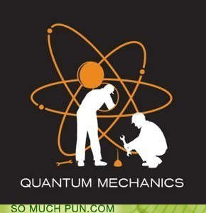 a cartoon of two guys fixing a nuclear power symbol...quantum mechanics
