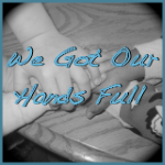 Grab button for We Got Our Hands Full