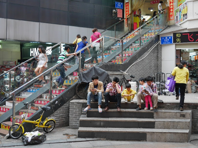 people sitting on steps at Dongmen