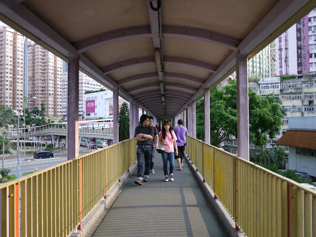 people walking on an elevated walkway in Tsuen Wan, Hong Kong