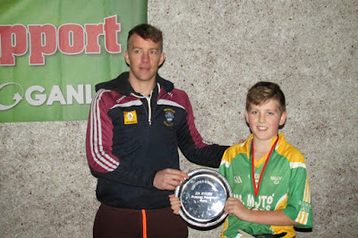 Doron Harte presents Jim McHugh Memorial Plate to Ryan Greenwood, Millmore Gaels Captain