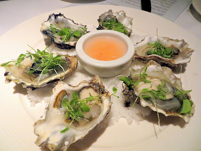 Netarts Oysters on the half shell with citrus mignonette at Bluehour Portland