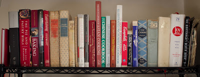 Cookbook collection on the pantry shelf