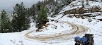 Snow-covered switchback in the road