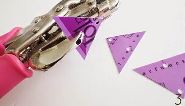 Furar triângulos de cartão