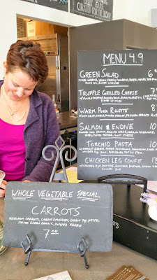Sandra Comstock and the Menu at Glyph Café & Art Space. The ingredients are picked out at the Saturday Farmers market everyday by the chef and sous chef and then they prepare the menu weekly from there