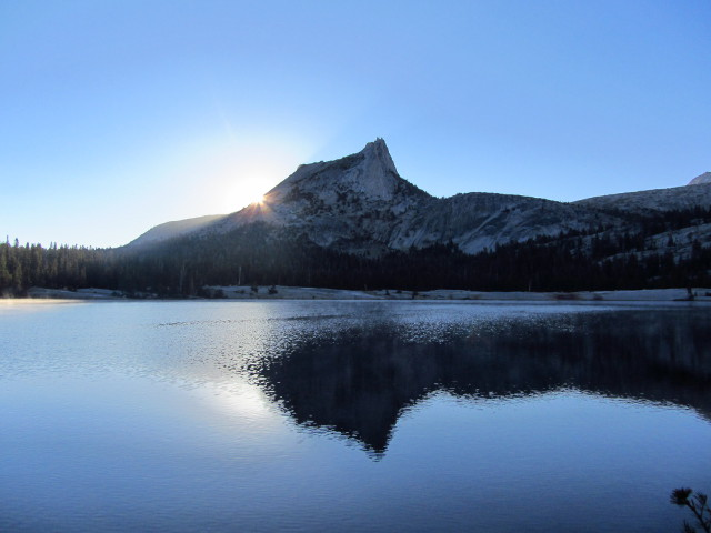 sun coming up over Cathedral Peak