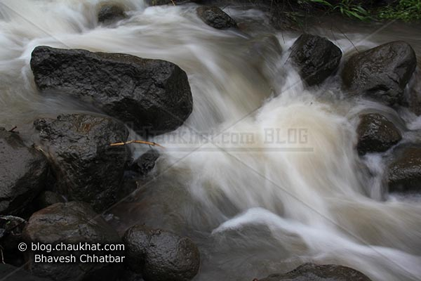 Water Stream flowing through rocks at the base of Raireshwar mountain fort
