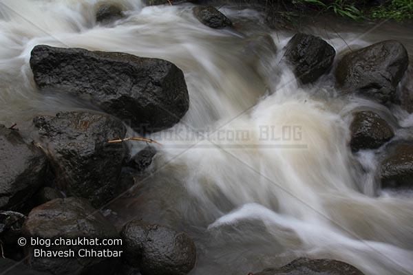 Water Stream flowing through rocks at the base of Raireshwar mountain fort
