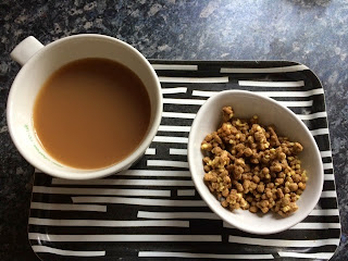 Cup of tea and bowl of all bran Golden Crunch cereal