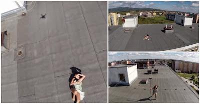 Drone apanha rapariga a fazer topless no topo de um prédio