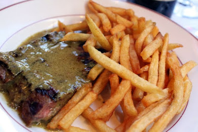 Steak frites at Relais de l'Entrecote restaurant in Paris France