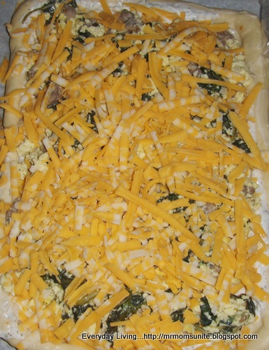 photo of the scrambled eggs with bacon, sausage,spinach, and feta cheese pizza
