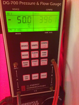 What a blower door air leakage reading looks like