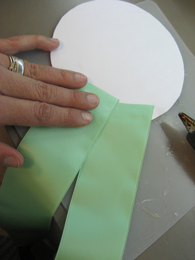Once the sewing was done, we began assembly, first attaching the tails to a round cardboard disc.