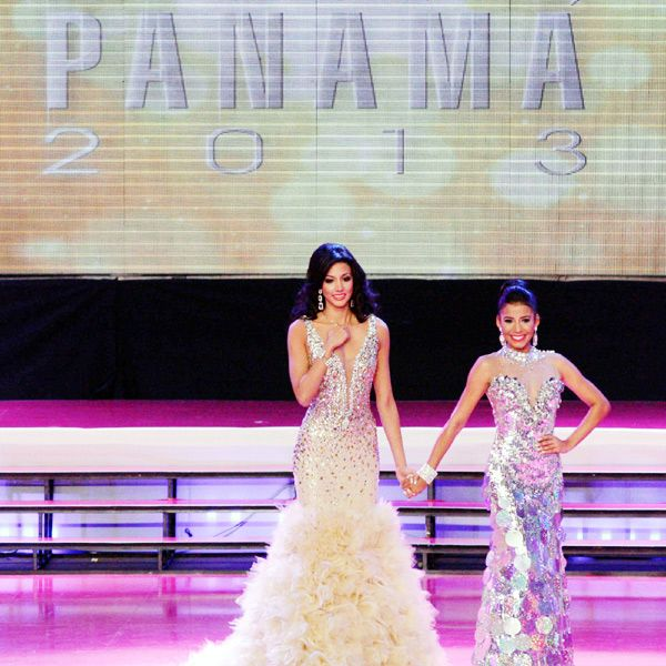 Miss Panama 2013 finalists, Carolina Brid, (L) and Maria Gabriela Sealy hold hands at the final stage of the beauty contest, held in Panama City, on April 30, 2013.