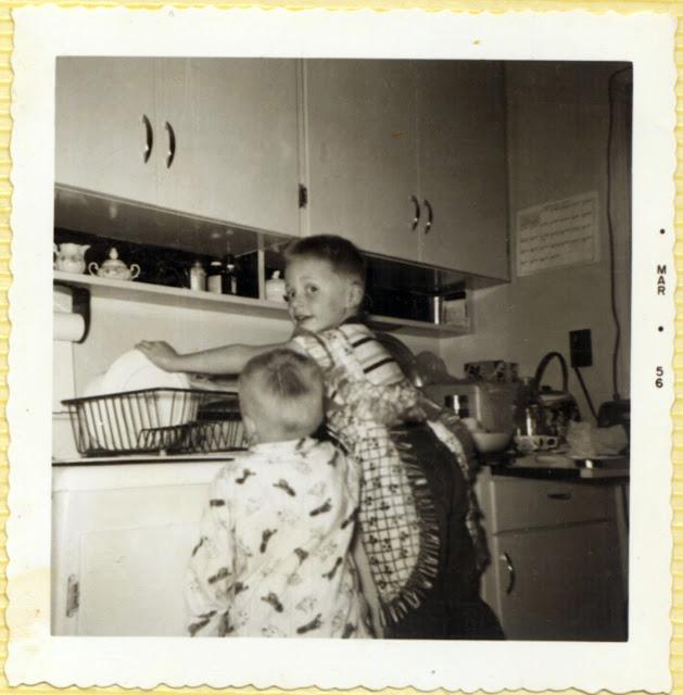 Rene washing dishes. (1956)