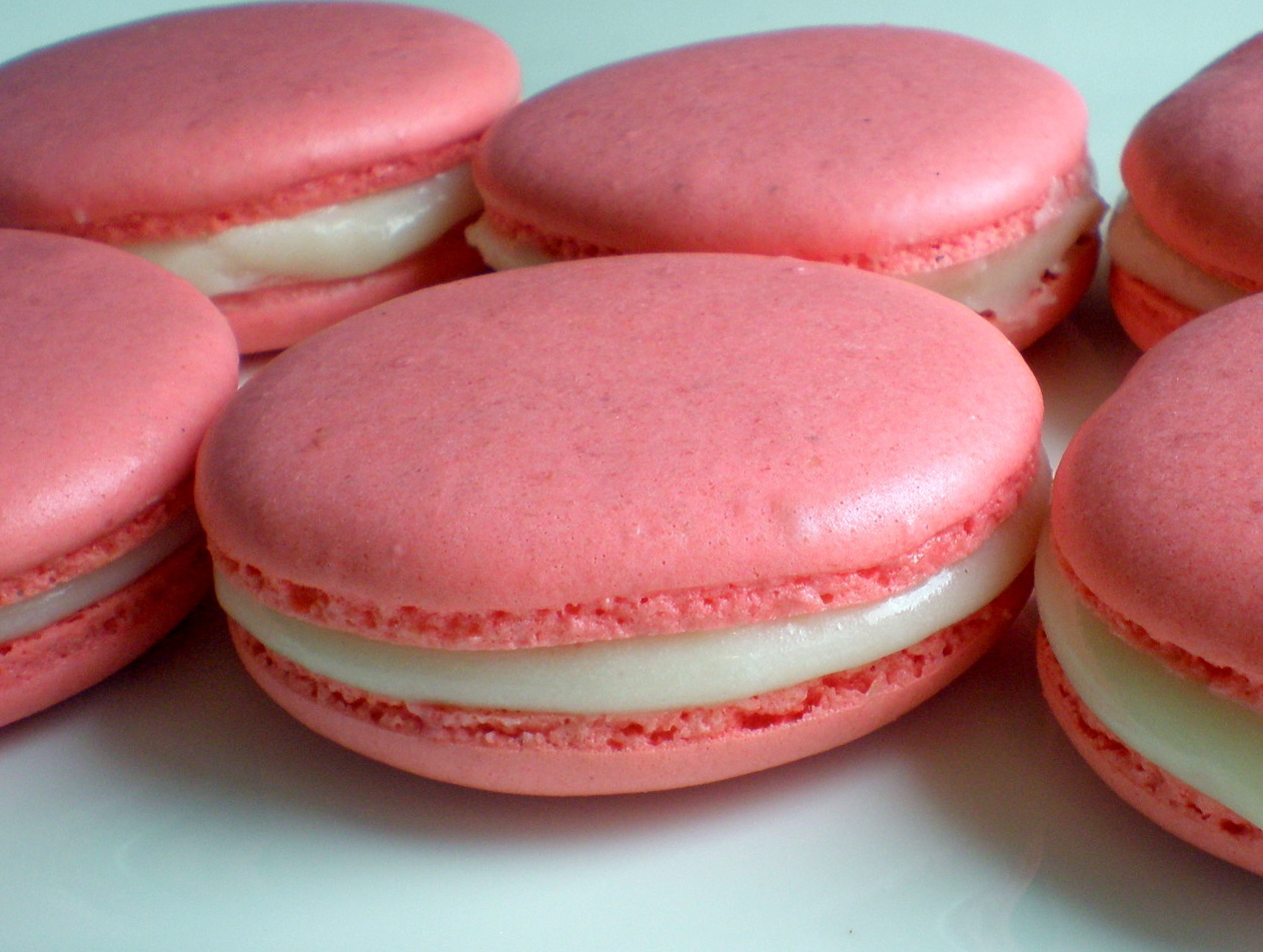 Strawberry macarons with vanilla cheesecake filling.