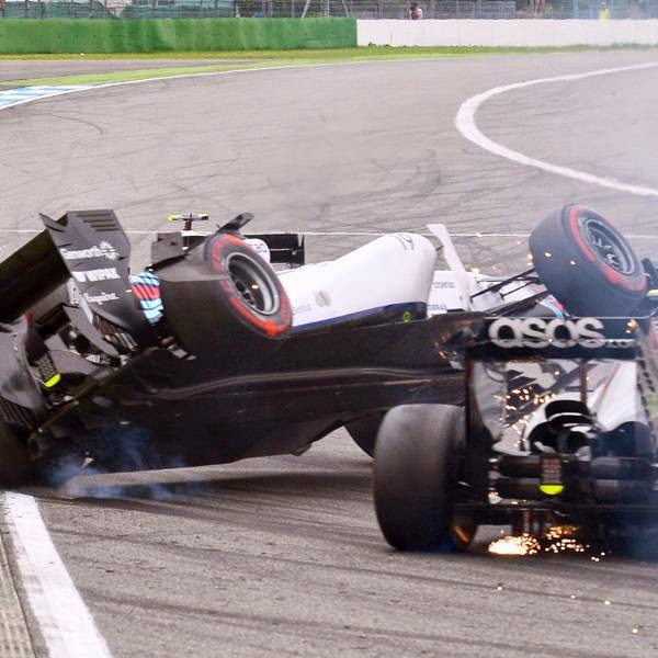Brazilian Formula One driver Felipe Massa (C) of Williams collides with Danish driver Kevin Magnussen (R) of McLaren Mercedes after the start of the German Formula One Grand Prix at the Hockenheimring race track in Hockenheim, Germany, 20 July 2014.