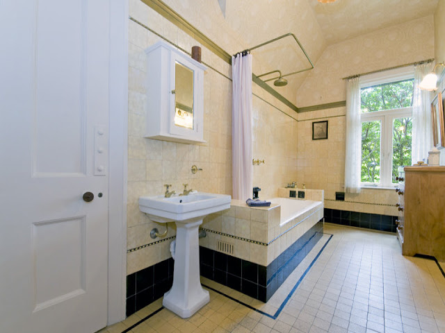 Almost original inter-war style bathroom with classic hand basin and pine dresser.