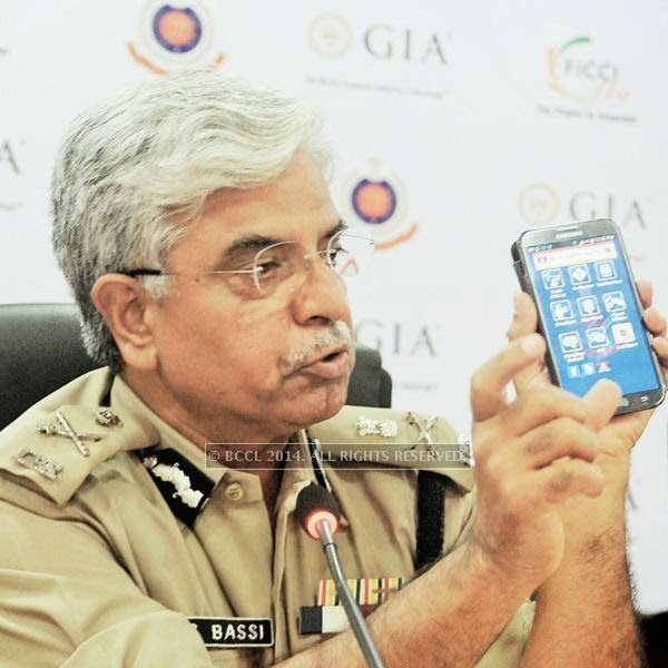 BS Bassi, Commissioner of Police, showing the Police App during a discussion on the issue of women safety, held at Federation of Indian Chambers of Commerce and Industry (FICCI) FLO, hosted by Harjinder Kaur in Delhi.