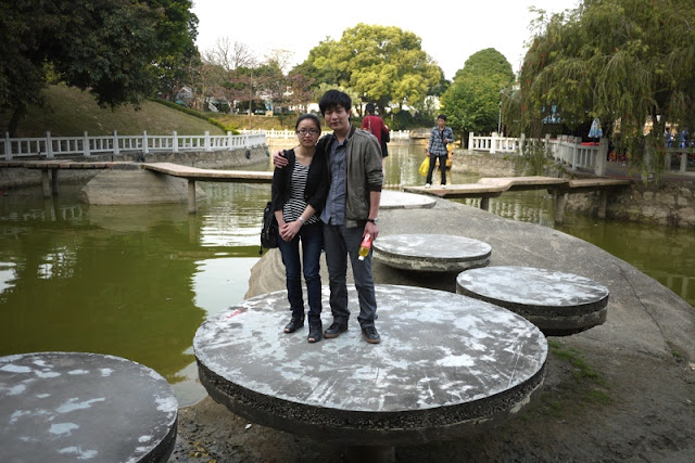Couple standing on a platform in a pond at Jingshan Park in Zhuhai