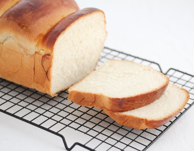 a loaf of hokkaido bread with two pieces sliced