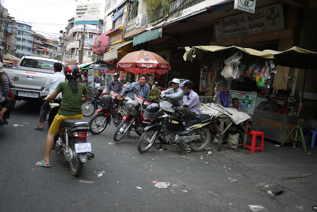men sitting on motorbikes at the roadside