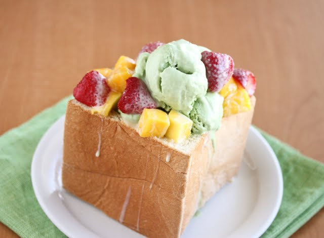 photo of brick toast topped with ice cream and fresh fruit