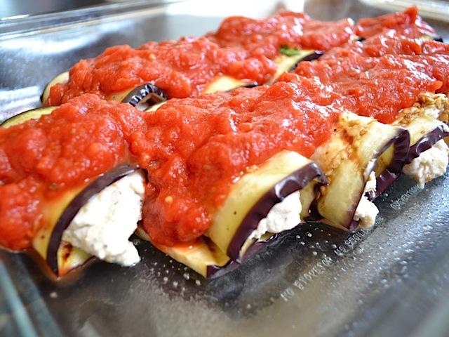sauce on eggplant rolls