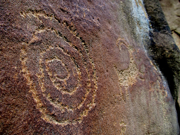 Spiral and sheep petroglyphs
