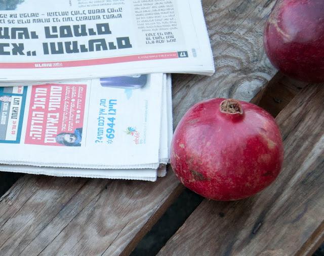 pomegranate, table, newspaper