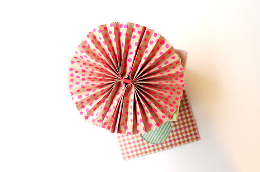 Use your gift wrapping paper scraps to make accordion fan paper present bows. Fold your piece of paper of any size like an accordion fan and fasten in the centre with mt masking tape.