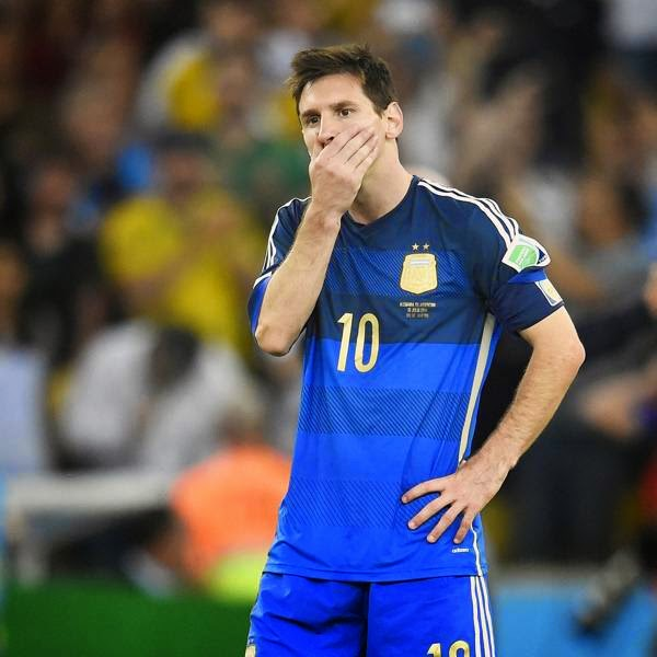 Argentina's forward and captain Lionel Messi reacts after losing the 2014 FIFA World Cup final football match between Germany and Argentina 1-0 following extra-time at the Maracana Stadium, in Rio de Janeiro, on July 13, 2014.