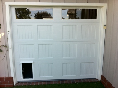 Garage door doggie door overhead door brunswick for Dog door for garage door