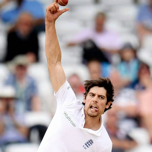 England's captain Alastair Cook bowls during the first cricket test match against India at Trent Bridge cricket ground in Nottingham, England July 13, 2014.