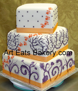 Three tier square custom modern fondant wedding cake with orange Clemson tiger paws and purple designs