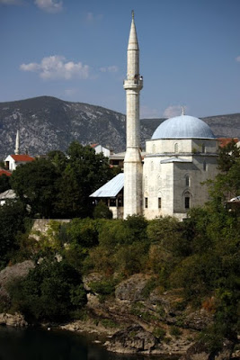 Mosque above the river in Mostar Bosnia and Herzegovina