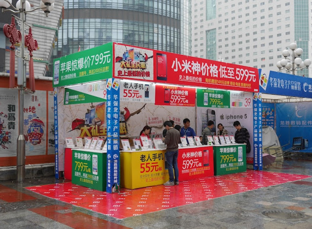 large outdoor booth selling mobile phones at Huaqiangbei