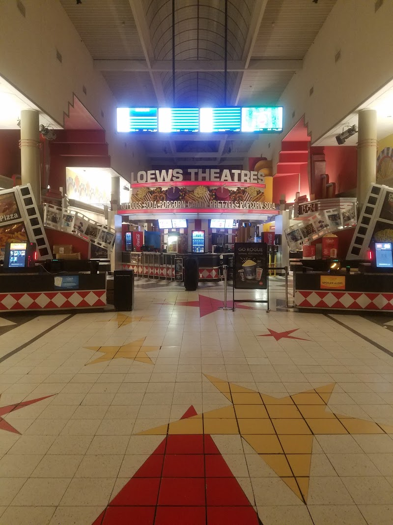Where can you find movie times for the Monmouth Mall theater?